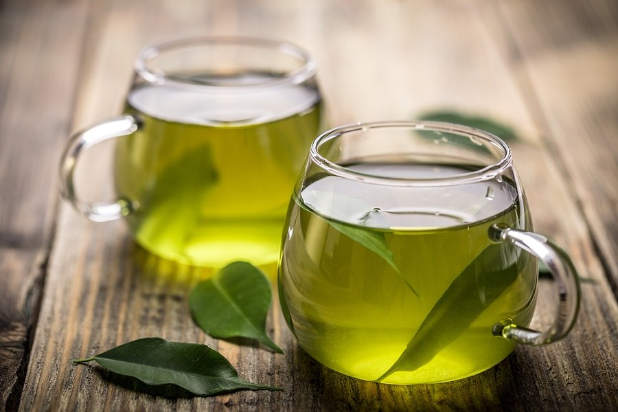 14 Benefits of Green Tea + Side Effects & Risks